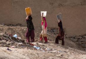 Women carrying water in Kabul, Afghanistan